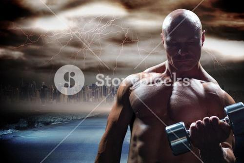 Composite image of concentrated bodybuilder lifting dumbbell