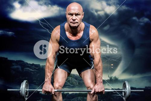Composite image of portrait of muscular man exercising with crossfit