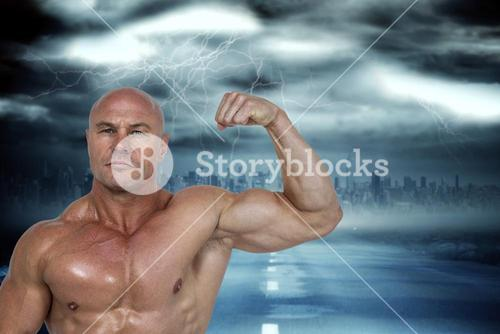 Composite image of portrait of muscular man flexing bicep