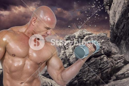 Composite image of bodybuilder concentrating while lifting dumbbells