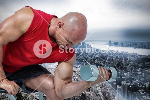 Composite image of bald man exercising with dumbbells while sitting on bench press
