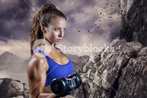 Composite image of side view of fit woman lifting dumbbell
