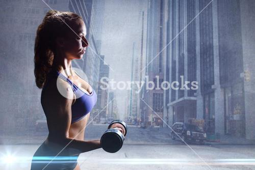 Composite image of side view of sexy woman lifting dumbbell