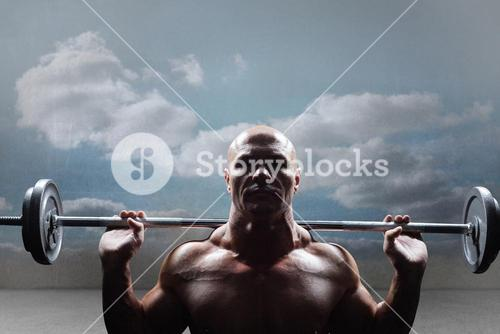 Composite image of portrait of bald man lifting crossfit