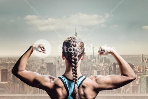 Composite image of rear view of woman with braided hair flexing muscles