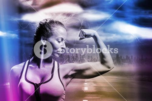 Composite image of fit woman flexing muscles