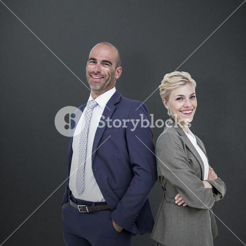 Composite image of  smiling business people back-to-back