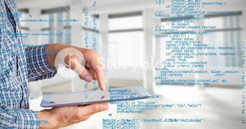Composite image of geeky businessman using his tablet pc