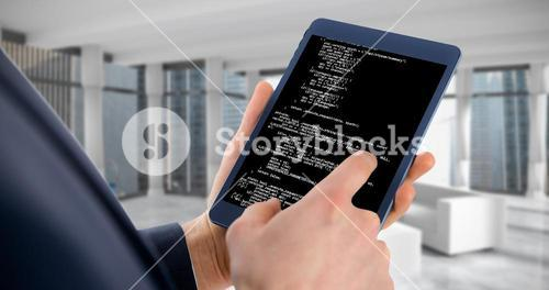 Composite image of businessman using digital tablet over white background