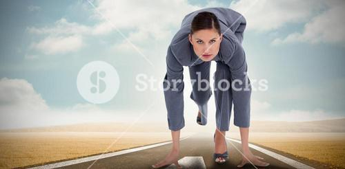 Composite image of tradeswoman in sprinting position