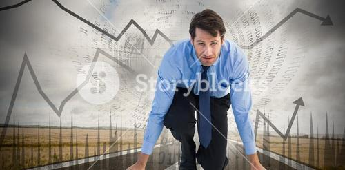 Composite image of focused businessman ready to race