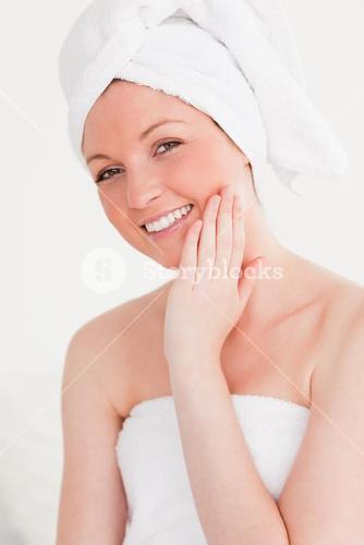Good looking young woman wearing towel