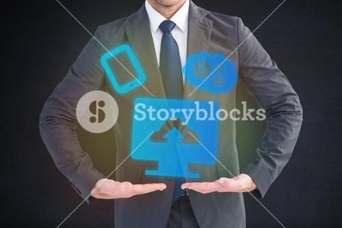 Composite image of businessman standing with hands out