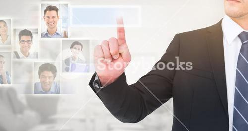 Composite image of unsmiling businessman pointing his finger