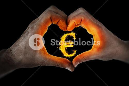 Composite image of couple making heart shape with hands