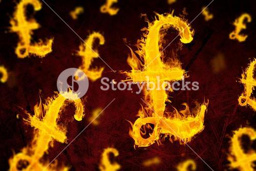 Composite image of british pound on fire