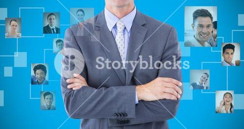 Composite image of portrait of smiling businessman standing hands folded