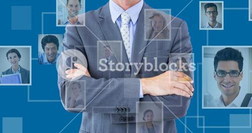 Composite image of midsection of businessman standing arms crossed