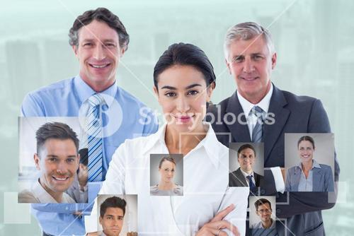 Composite image of smiling business people brainstorming together