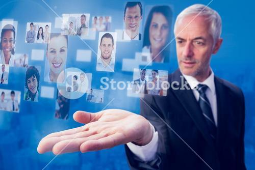 Composite image of concentrated businessman with palm up