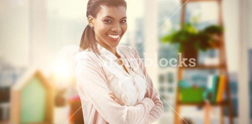 Composite image of smiling crestive business woman