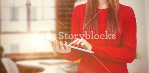 Composite image of mid section of a hipster woman using her tablet