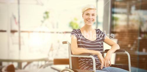 Composite image of smiling woman in a wheelchair
