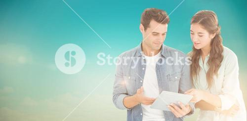 Composite image of business people with tablet