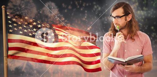 Composite image of thoughtful hipster holding pen and book