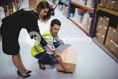 Manager showing clipboard to worker