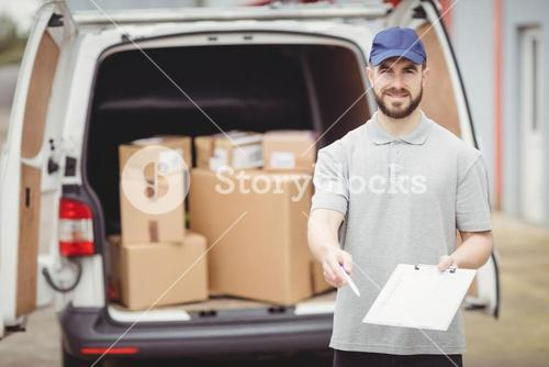 Delivery man holding clipboard