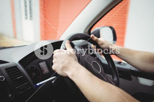 Close-up of hands holding steering wheel