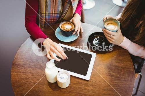 Friends using tablet together