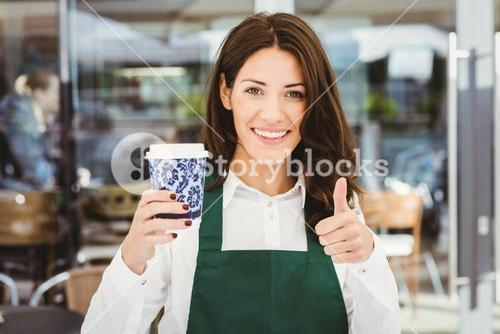 Smiling waitress serving a coffee