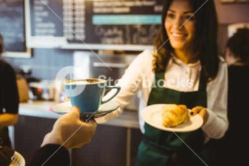 Waitress serving a cup of coffee