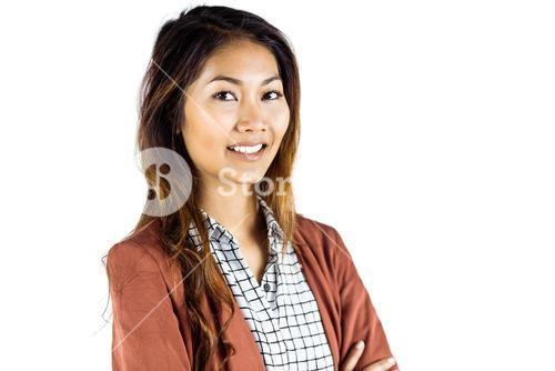 Smiling businesswoman with crossed arms