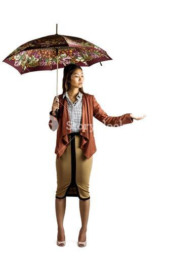 Businesswoman with an umbrella feeling the rain