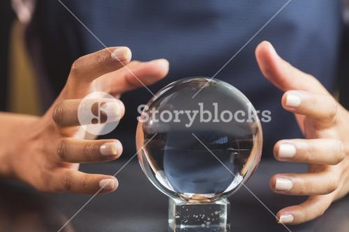 Businesswoman using crystal ball