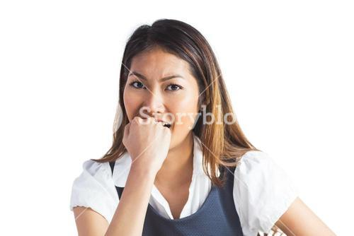 Businesswoman biting her fist