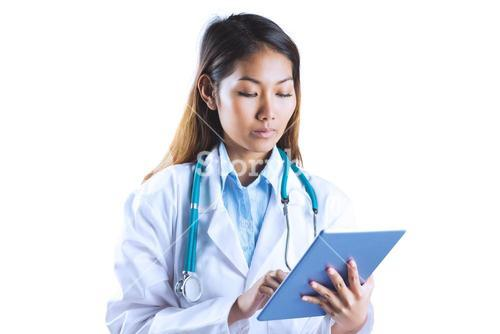 Asian doctor using tablet