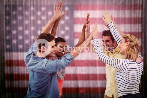 Composite image of happy creative team giving high fives to each other