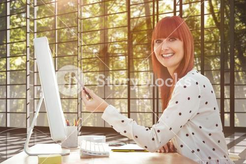 Composite image of smiling hipster woman pointing screen with pen