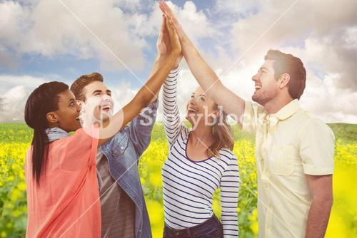 Composite image of happy creative team giving a motivational gesture