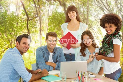 Composite image of smiling casual colleagues in a meeting