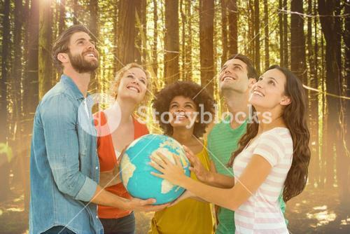 Composite image of young creative business people with a globe