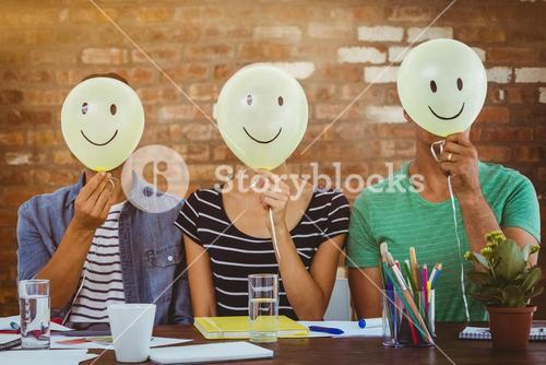 Composite image of casual people sitting on couch with smile head