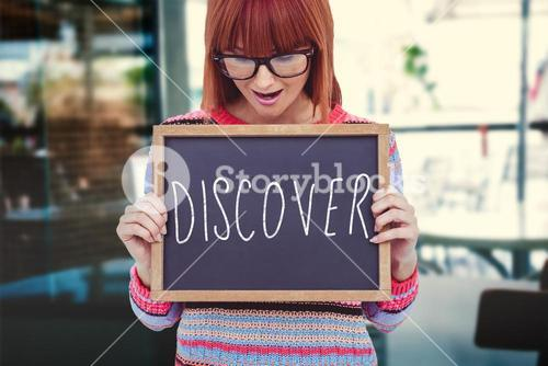 Composite image of smiling hipster woman holding blackboard