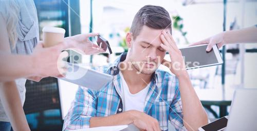 Composite image of depressed businessman with head in hand