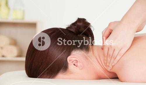 Redhaired woman having a back massage