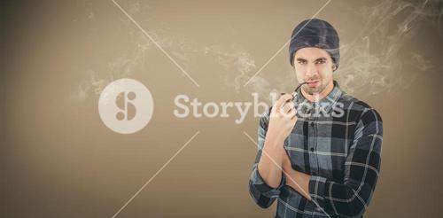 Composite image of portrait of confident hipster smoking pipe